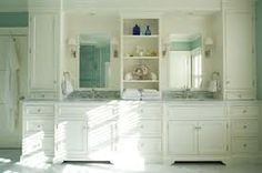 master bath double vanity....want the shelves between sinks, but with doors and want open space underneath for chair/stool