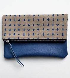 Arrows and leather clutch