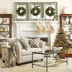 love this idea with the mirrors and the wreaths..and love the living room itself!