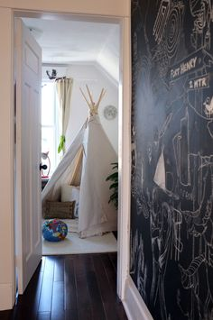 Kids play tent and chalkboard walls // Apartment Therapy.  Playroom