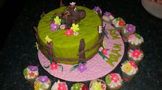Horse/donkey birthday cake with floral cupcakes