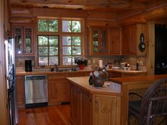 """This kitchen is in a lake home on Long Lake in Phelps, WI. The homeowner wanted to have the """"Northwoods"""" feel. They accomplished this with plenty of attention to detail and some great decorating ideas as well. -- Of course the home owner and contractor need to work together. Here is a quote form the homeowner. """"North Twin Builders did an excellent job in designing and building our home in Northern Wisconsin, and we would highly recommend them to anyone without reservation.""""   ~ Bob & Denise…"""