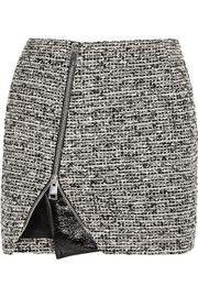 Mini-jupe en tweed de laine mélangée et cuir verni synthétique