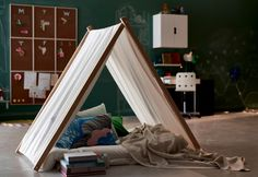 My kids love playing in tents and often make their own out of the kitchen table or the couch. Check out this easy wooden framed tent you can easily make at home to keep the kids entertained for hours. How to make a tent   What you'll need: 4 pieces of 2.5 x 4 x 150 cm wood 3 pieces of 1.5 x 100 cm dowel rods 4.5 metres of metre width fabric washi tape (or sticky tape) Instructions: Drill 2 holes, 1.5 cm in diameter in each of the wood. Drill the first hole 10 cm in from one end (this will…