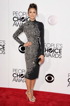 Best Dressed At People's Choice Awards 2014...NINA DOBREV Dobrev arrived at the 2014 People's Choice Awards looking impossibly elegant in a high-collar long-sleeve Jenny Packham cocktail dress with crystal embellishments, styling it with a Kara Ross ring, a metallic box clutch and silver strappy heels.