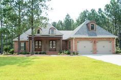 Very spacious 4 bedroom 2 bath Acadian design with many features. Open floor plan with large great room and dining area. Large kitchen with island, walk in pantry, cooktop, double ovens, and eating ba