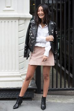 Aziza Azim in an embellished moto jacket and pale pink skirt