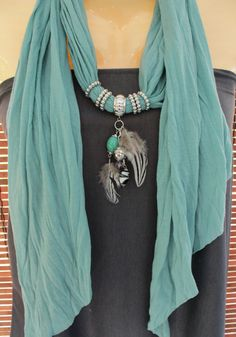 Cool turquoise beaded scarf necklace with feathers.