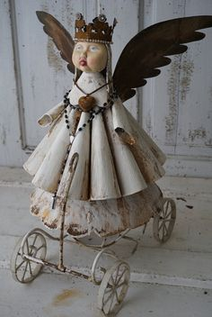 Metal Santos angel sculpture w/ wheeled cart by AnitaSperoDesign