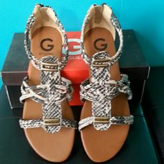 "NIB G By Guess Gladiator Snakeskin Sandals Complete with a zippered back for easy on/off with cute metal decor in front . Great for flaunting those manicures in spring or summer while being comfy ;) Measures: back to front 10"" :) G by Guess Shoes Sandals"