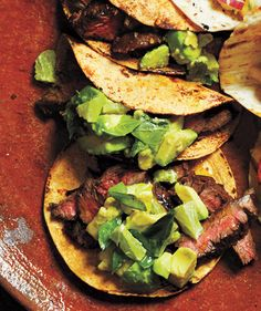 A marinade of garlic, lime juice, vinegar, and red pepper infuses skirt steak (a fatty, quick-cooking cut of meat) with bright, zesty flavors. After an hour of marinating time, grill the meat until charred and medium-rare, then top with a chunky avocado-lime salsa.