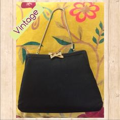 """Vintage HL Black Satin Handbag. 1940s. Vintage HL Black Satin Handbag. 1940s.   Great vintage condition. One crystal missing on clasp but hard to notice. See picture 4. Slight crease on back. Satin in great shape. No tears or holes.  8"""" x 6"""" x 1.5"""".  Gold chain handle. Closure works great. Vintage Bags"""