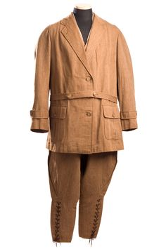 Man's riding suit, early 20th century. This brown suit with jodhpur pants and matching vest came from the Logan House at 32 Church Street. It was probably worn by the house's owner, William Turner Logan (1874-1941). Logan, a practicing lawyer in Charleston, was a state representative from 1901-1904, and a Representative in Washington from 1921-1925. He married Louise Gibert Lesesne in 1909.