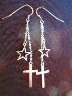 Silver stars and crosses drop earrings via crimeajewel. Click on the image to see more!
