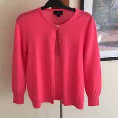 ✨J. Crew 100% Italian Cashmere 3/4 sleeve cardigan ✨J. Crew 100% Italian cashmere 3/4 sleeve cardigan, size M. Absolutely gorgeous coral color with beautiful tangerine buttons. Lightweight and So perfect for Spring!  worn 3x. Perfect condition and just dry cleaned ready for new home! Don't pass this one up! Stunning and so pretty over a flowy summer blouse or dress! Make me an offer! [15% off bundles] ☺️ J. Crew Sweaters Cardigans