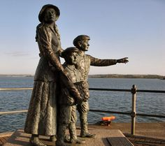 Cobh Harbour on the south coast of County Cork - This is the statue of Annie Moore and her brothers as they left for America.  She was the first immigrant admitted at Ellis Island.
