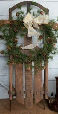 an old child's sleigh made into a Christmas wreath