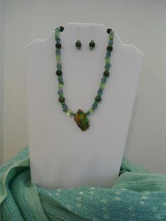 Green Statement necklace & earrings set: Imperial Green pendant with Peridot beads, Jade Chips, Fancy Jasper and Green Crackle Czech glass by ATouchOfT on Etsy