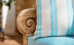 Lovely Balinese bench with striped linen cushions in turquoise blue. True ibiza style - simply gorgeous