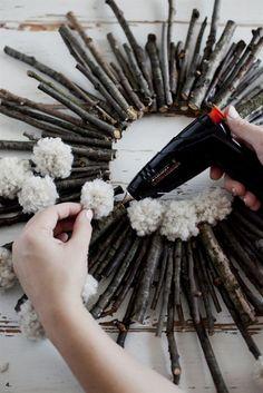 Make a twig and pom pom starburst wreath— It's practically free! #ChristmasWreaths