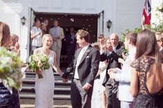 Great photo of the bride and groom laughing during the ceremony exit, surrounded by guests blowing bubbles!  At the Stowe Community Church in VT...
