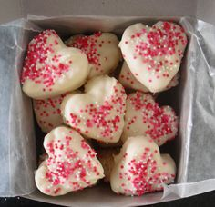 Valentine Rice Krispie treats- shaped with cookie cutter, dipped in almond bark and covered in sprinkles. sounds tasty