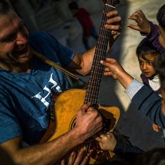 Photo @michaelchristopherbrown. Im in Jordan this week with several artists teaching Syrian refugee children how to draw paint make music and take pictures. In this image Luc Reynaud of @lucandthelovingtons leads a group of kids in song and dance. Artists Luc Glen Shackley Benjamin Swatez and I are from Washington State - Sometimes the stars align and people come together in a way where everyone feels like it was meant to be as we do here. This is a unique art program in Jordan run by a…
