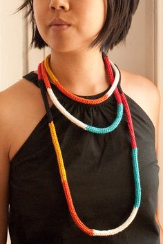 A fun colorful i-cord necklace that you can wear multiple ways. It's one long piece, so wrap it as many times around as you like. A great piece for the fall/winter that's soft and bold. It has a tribal, but also modern feel. Knit with a 80% cotton, 20% wool blend yarn.