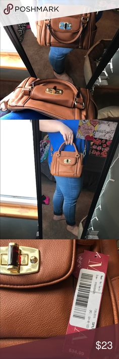 Merona crossbody. LIKE NEW! Used a couple times, off and on. Such a cute satchel! You can wear as a crossbody or a handbag. Color is butternut. And it has gold hardware! Clean smoke free home. All offers WILL BE declined! Any questions please ask💕 Merona Bags Crossbody Bags