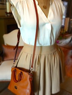 She's Gone Preppy. For summer/spring I would change the tan purse for a brightly colored vibrant one!