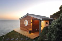Tiny beach house. color on the sunset and the house only would be nice