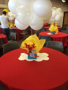 Little aviator centerpieces. I used white & clear balloons as clouds.