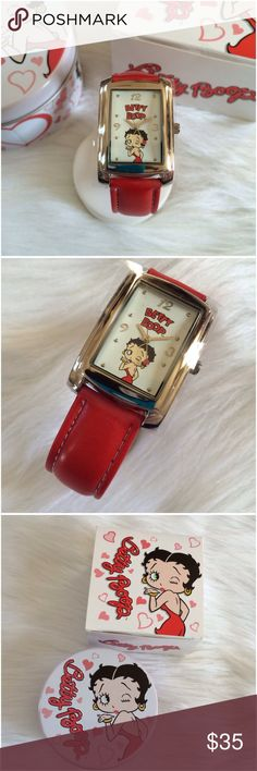 BETTY BOOP LOVE 'N' KISSES WATCH BETTY BOOP LOVE 'N' KISSES WATCH   Charming ladies watch featuring ared leather-like strap with black top stiching and silver sunray brass dial with a winking Betty Boop blowing a kiss. 