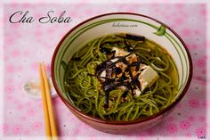 Cha Soba (grean tea noodles)  Ingredients(serves 2): 200g cha soba, 750ml dashi, 1tbs mirin,1tbs soy sauce, 1 tofu, 1 sheet of dried nori seaweed cut into strips, 3tsp sesame seeds  Method: Cook noodle in lightly salted boiling water al dente. Bring dashi to a boil, add soy sauce, blanch tofu, cut into cubes, arrange on top of the noodles. Pour the soup into the noodle bowls, sprinkle with nori strips and sesame seeds.  Source: kokotaru.com