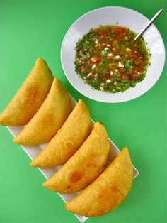 Empanadas come in myriad regional variations – with different doughs, fillings, and cooking methods. Here we dive into some of the delicious empanadas Latin America has to offer. Colombian Dishes, Colombian Cuisine, Columbian Recipes, Empanadas Recipe, Chicken Empanadas, Comida Latina, Caribbean Recipes, Latin Food, International Recipes