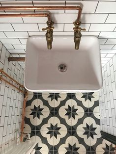A Tiny Tiled Powder Room Before And After On Design*Sponge #bathroomtilefloorideasneutral