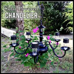 DIY Solar lights chandelier - take the bottom off of inexpensive solar powered lights and place in chandelier- hang from a tree!