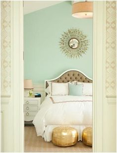 Seafoam walls + white bedding = so serene