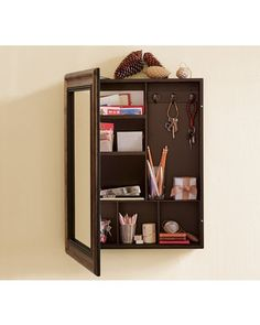 This wall mounted message center is disguised by a mirror. Get it here: http://www.bhg.com/shop/pottery-barn-antique-mirror-message-center-p505c373882a71c80fdfdcc63.html