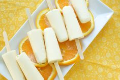 Orange Creamsicles  1 cup orange juice (fresh or frozen. you could also use orange juice concentrate for a stronger orange flavor)  1 cup heavy cream (you could also substitute melted/very soft vanilla ice cream)  3 tablespoons honey or agave nectar  1/4 teaspoon orange extract  1/2 teaspoon vanilla extract  whisk all together   set for 30-60 minutes, then add popsicle sticks. Freeze for another 4-6 hours or until frozen