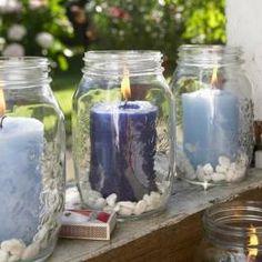 Potes de vidro viram porta-velas