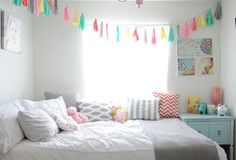 The little banner strung between the walls of this room is so cute!  I wonder if you tie hankies on a string to make it?