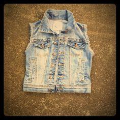 "American Rag jean Vest Cute jean vest with frayed armholes in light denim wash.  Measures 33"" bust . American Rag Tops"