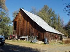 Barn on  Reading Creek Ranch  in the foothills of the Trinity Alps in Northern California. The story goes that a group of itinerant Irish barn builders came through the area in the early 1900's, constructing both this and the big hay barns at the neighboring ranch (the old Clement/RK ranch.) The barn holds ~40 tons of hay.  It includes an enclosed tack room, ample space for storage, and a small enclosed stall which adjoins a roofed area gated into the corral