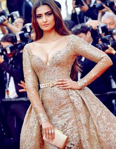 Sonam Kapoor Huge Melons In Golden Gown at the Red Carpet of Cannes 2017...
