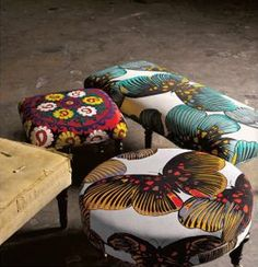 Anthropologie Ottomans,I feel a theme coming on! Where can I get fabric like this!