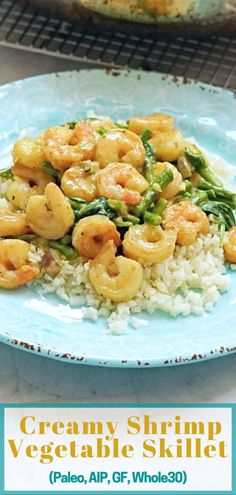 If you're craving seafood, this creamy warm dish really hits the spot. It combines shrimp, asparagus, spinach, and a coconut milk-based cream sauce with a delicious spice blend. This meal is simple and ready in 30 minutes, so it works well as a quick weeknight meal. It is Paleo, AIP compliant, gluten-free, dairy-free, and Whole30 compliant (with one small adjustment). #aip #paleo #whole30 #easydinner #glutenfree #dairyfree #autoimmunepaleo #autoimmuneprotocol #shrimp