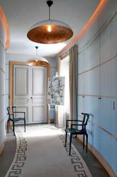 I like the stylized neoclassical greek key motif on the runner in this beautiful hallway of a Paris apartment designed by Jean-Louis Deniot.