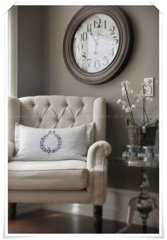 Wall color, chair and pillow.   Not crazy about the clock, but a painting or maybe a mirror instead.