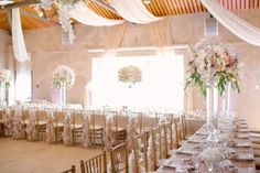 Blush and gold floral decor created by Akiko Floral Artistry.  Photo Credit:  Milton Photography  #phalaenopsis #orchids #blush #gold #blushandgold #ivory #tulips #roses #peonies #hydrangea #ceiling #draping